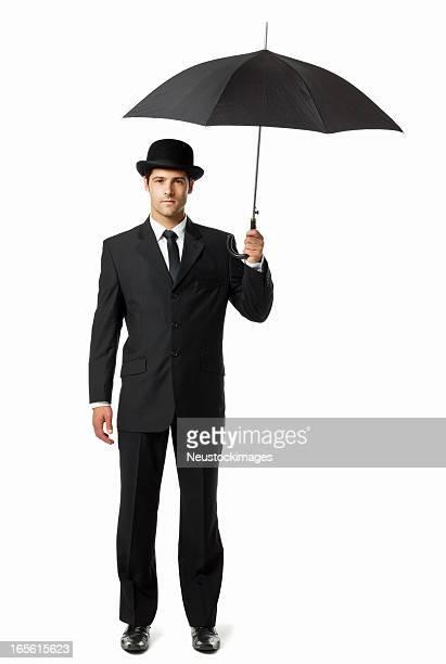 Mann hält einen Regenschirm-isoliert