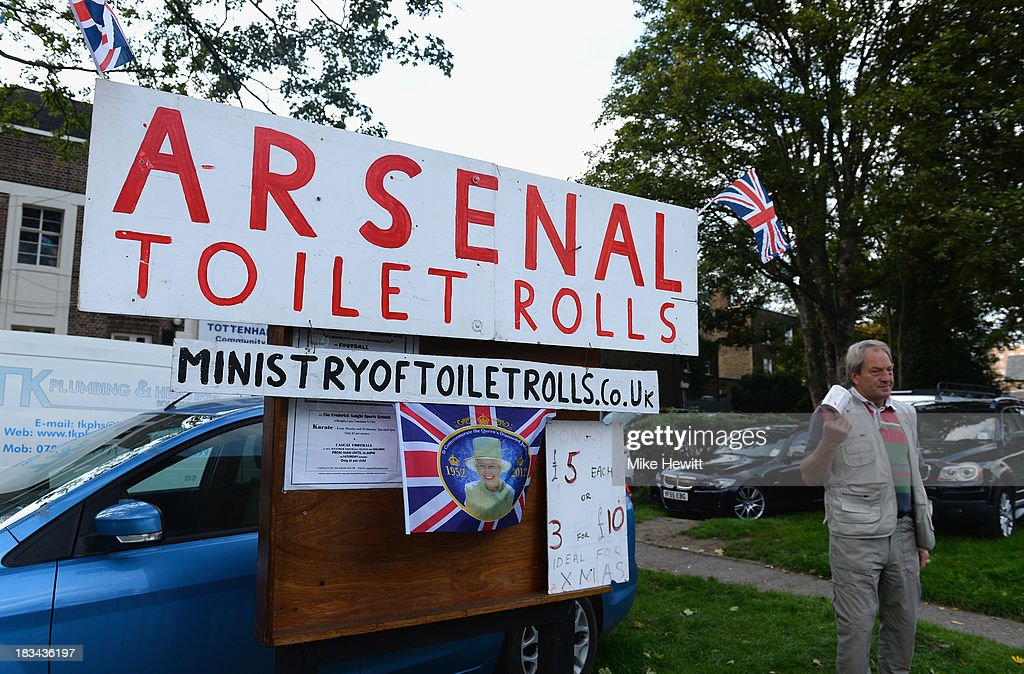 A gentleman sells 'Arsenal toilet rolls' prior to the Barclays Premier League match between Tottenham Hotspur and West Ham United at White Hart Lane on October 6, 2013 in London, England.