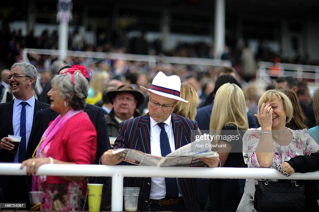 A gentleman studies the form at Chester racecourse on May 08 2014 in Chester England
