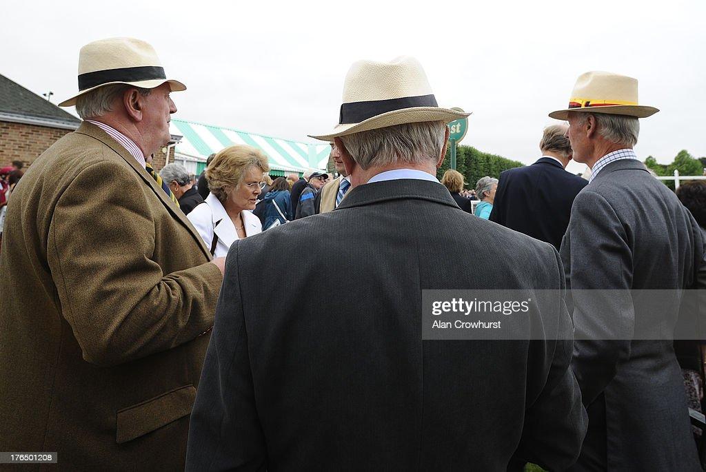 Gentlemen discuss the form at Salisbury racecourse on August 14, 2013 in Salisbury, England.