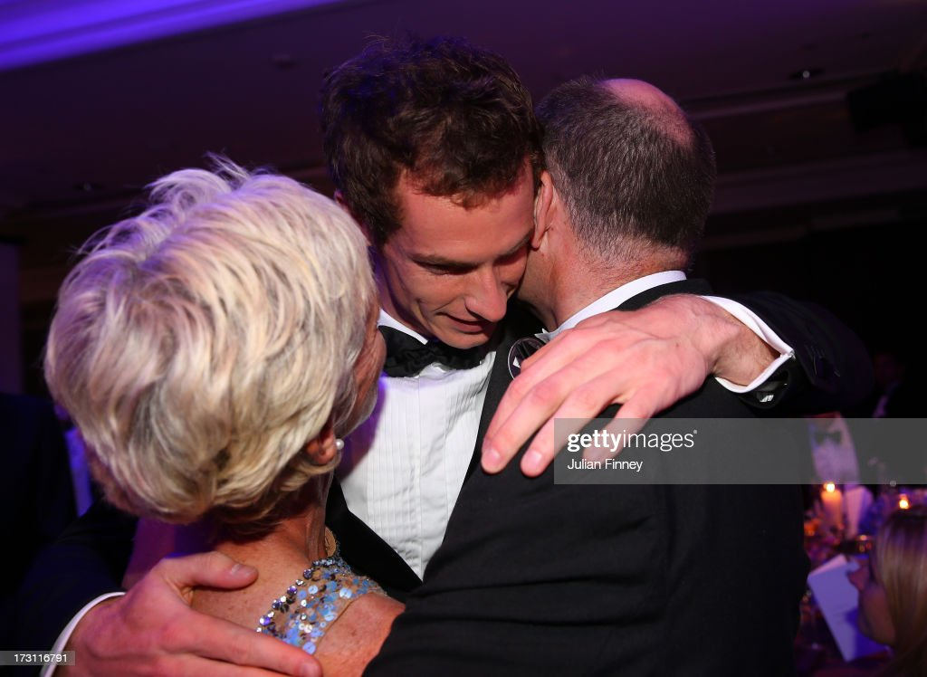 Gentlemen's Singles Champion Andy Murray of Great Britain (C) hugs his parents <a gi-track='captionPersonalityLinkClicked' href=/galleries/search?phrase=Judy+Murray&family=editorial&specificpeople=582324 ng-click='$event.stopPropagation()'>Judy Murray</a> and William Murray during the Wimbledon Championships 2013 Winners Ball at InterContinental Park Lane Hotel on July 7, 2013 in London, England.