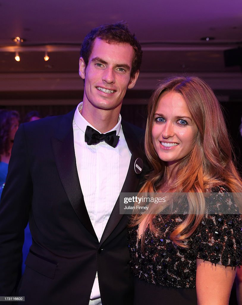 Gentlemen's Singles Champion <a gi-track='captionPersonalityLinkClicked' href=/galleries/search?phrase=Andy+Murray+-+Tennis+Player&family=editorial&specificpeople=200668 ng-click='$event.stopPropagation()'>Andy Murray</a> of Great Britain poses with his girlfriend Kim Sears during the Wimbledon Championships 2013 Winners Ball at InterContinental Park Lane Hotel on July 7, 2013 in London, England.
