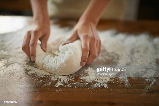 Gently working the dough