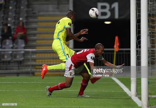Gent's forward Kalifa Coulibaly from Mali with SC Braga's Brazilian defender Baiano in action during the UEFA Europa League match between SC Braga...
