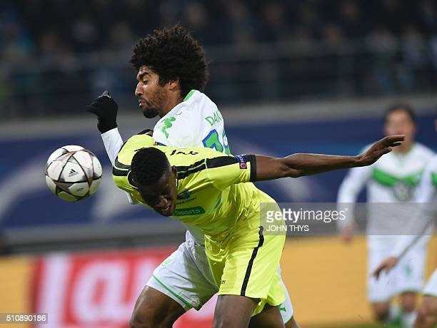 Gent's Malian forward Kalifa Coulibaly celebrates after scoring during the UEFA Champions League football match between Gent and Wolfsburg at...