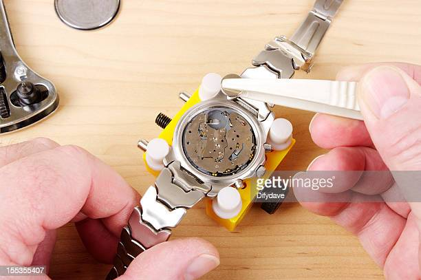 Gents Wristwatch With Back Removed And Tools For Battery Change