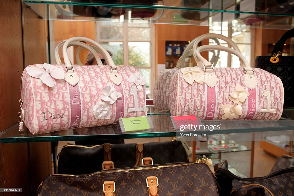 Genuine and counterfeit Dior bags are displayed at the Counterfeit Museum on June 25 2009 in Paris France The museum serves to highlight the impact...