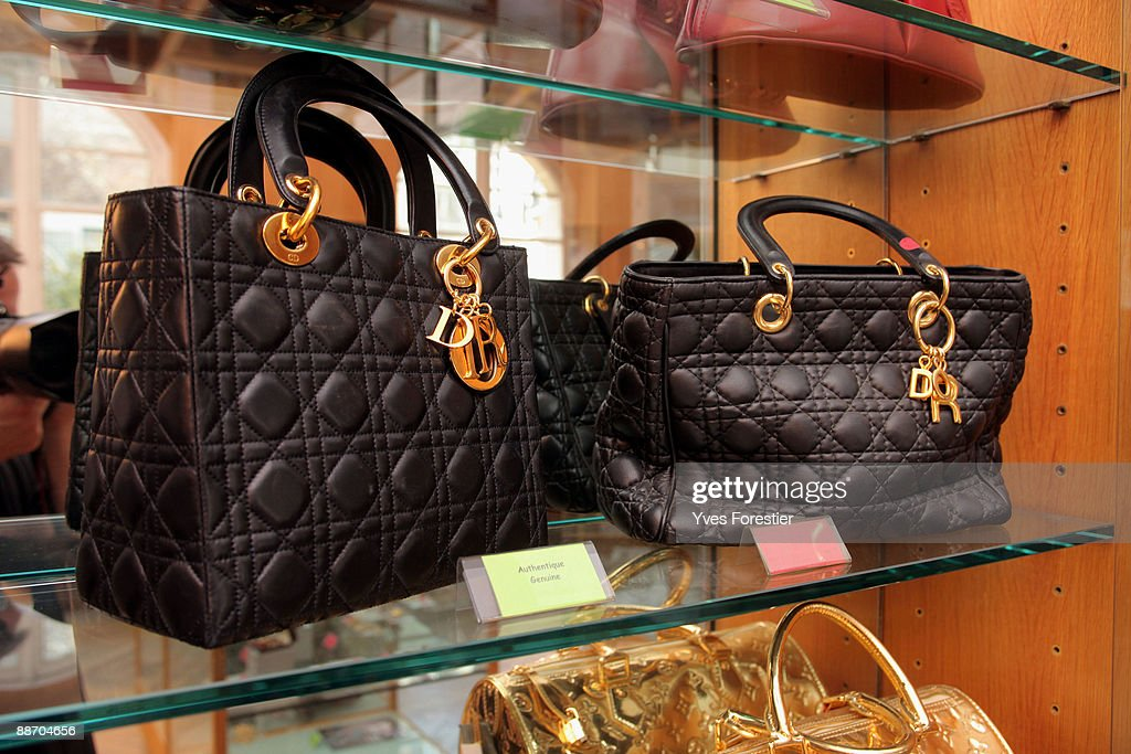 Genuine and counterfeit Dior bags displayed at the Counterfeit Museum on June 25 2009 in Paris France The museum serves to highlight the impact that...