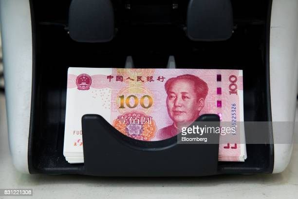 Genuine Chinese onehundred yuan banknotes are seen on a counting machine at the Counterfeit Notes Response Center of KEB Hana Bank in Seoul South...
