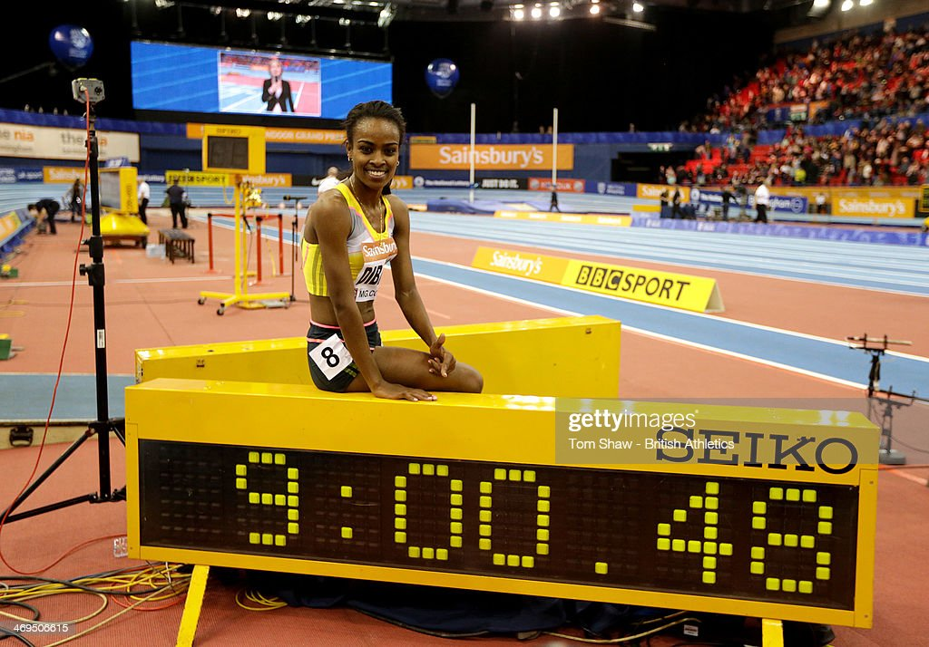 <a gi-track='captionPersonalityLinkClicked' href=/galleries/search?phrase=Genzebe+Dibaba&family=editorial&specificpeople=5083525 ng-click='$event.stopPropagation()'>Genzebe Dibaba</a> of Ethiopia celebrates her new world record in the womens two miles during the Sainsbury's Indoor Grand Prix at the National Indoor Arena on February 15, 2014 in Birmingham, England.