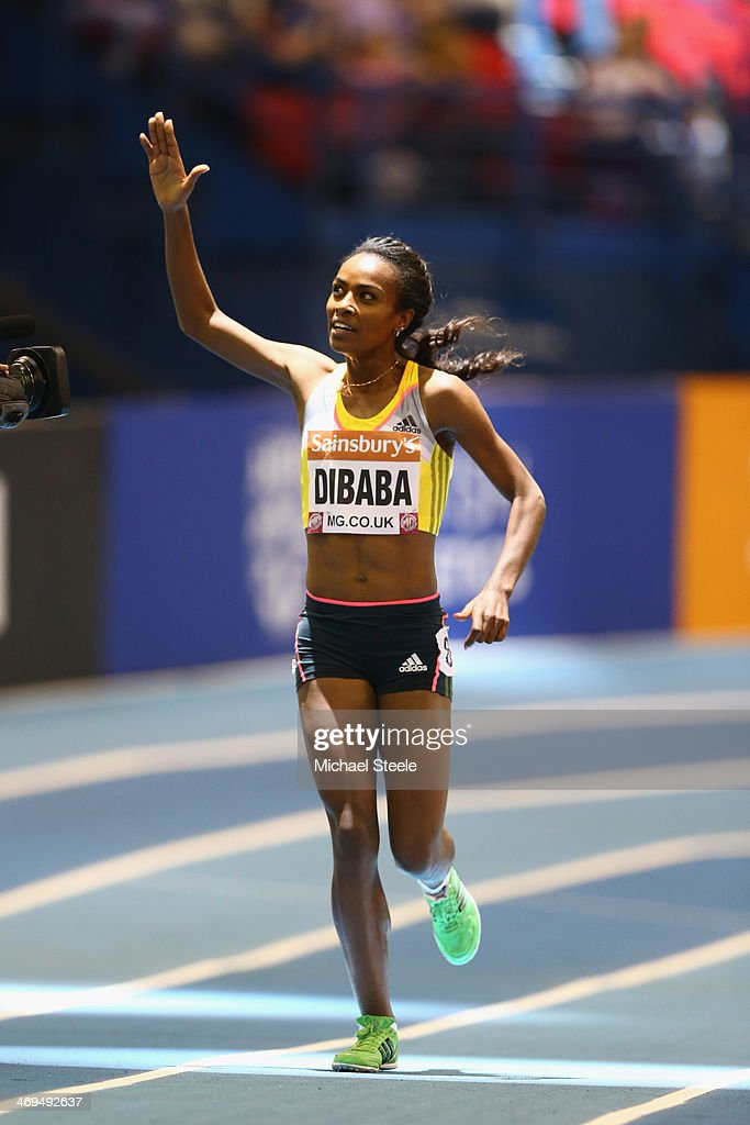<a gi-track='captionPersonalityLinkClicked' href=/galleries/search?phrase=Genzebe+Dibaba&family=editorial&specificpeople=5083525 ng-click='$event.stopPropagation()'>Genzebe Dibaba</a> of Ethiopia celebrates setting a new world record in the women's two mile during the Sainsbury's Indoor Grand Prix at the NIA Arena on February 15, 2014 in Birmingham, England.