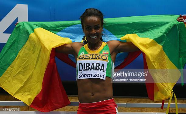 Genzebe Dibaba of Ethiopia celebrates winning the gold medal in the Women's 3000m final during day three of the IAAF World Indoor Championships at...