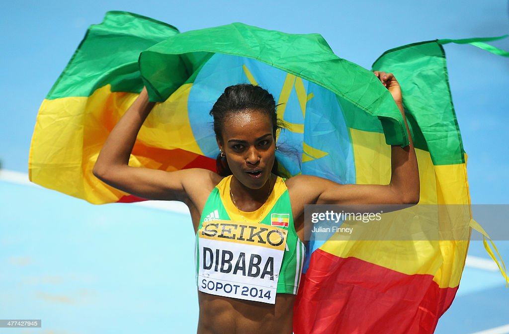 <a gi-track='captionPersonalityLinkClicked' href=/galleries/search?phrase=Genzebe+Dibaba&family=editorial&specificpeople=5083525 ng-click='$event.stopPropagation()'>Genzebe Dibaba</a> of Ethiopia celebrates winning the gold medal in the Women's 3000m final during day three of the IAAF World Indoor Championships at Ergo Arena on March 9, 2014 in Sopot, Poland.