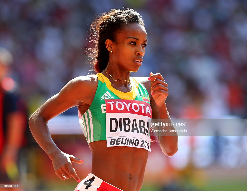 <a gi-track='captionPersonalityLinkClicked' href=/galleries/search?phrase=Genzebe+Dibaba&family=editorial&specificpeople=5083525 ng-click='$event.stopPropagation()'>Genzebe Dibaba</a> of Ethiopia competes in the Women's 5000 metres heats during day six of the 15th IAAF World Athletics Championships Beijing 2015 at Beijing National Stadium on August 27, 2015 in Beijing, China.