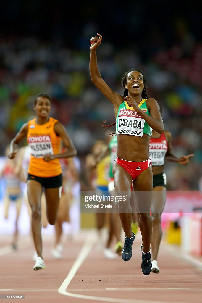 <a gi-track='captionPersonalityLinkClicked' href=/galleries/search?phrase=Genzebe+Dibaba&family=editorial&specificpeople=5083525 ng-click='$event.stopPropagation()'>Genzebe Dibaba</a> of Ethiopia crosses the finish line to win gold in the Women's 1500 metres final during day four of the 15th IAAF World Athletics Championships Beijing 2015 at Beijing National Stadium on August 25, 2015 in Beijing, China.