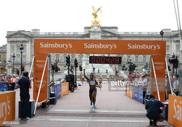 Genzebe Dibaba of Ethiopia crosses the finish line to win the women's mile race during the Sainsbury's Anniversary Games at Horse Guards Parade on...