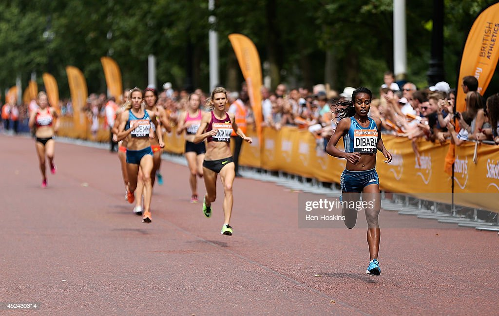 <a gi-track='captionPersonalityLinkClicked' href=/galleries/search?phrase=Genzebe+Dibaba&family=editorial&specificpeople=5083525 ng-click='$event.stopPropagation()'>Genzebe Dibaba</a> of Ethiopia leads the field during the women's mile race at the Sainsbury's Anniversary Games at Horse Guards Parade on July 20, 2014 in London, England.