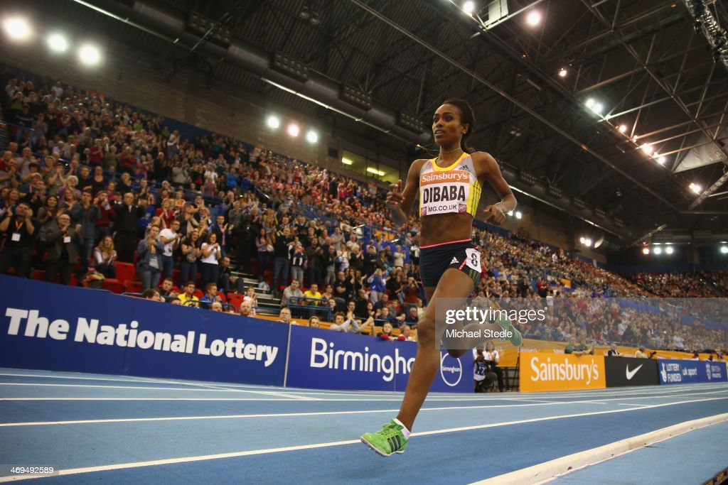 <a gi-track='captionPersonalityLinkClicked' href=/galleries/search?phrase=Genzebe+Dibaba&family=editorial&specificpeople=5083525 ng-click='$event.stopPropagation()'>Genzebe Dibaba</a> of Ethiopia on her way to setting a new world record in the women's two mile during the Sainsbury's Indoor Grand Prix at the NIA Arena on February 15, 2014 in Birmingham, England.