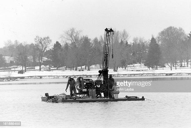 APR 2 1989 Geo technical engineers from Chen and Associates use a floating drilling rig to sample sediment from the bottom of Sloans Lake Chen and...