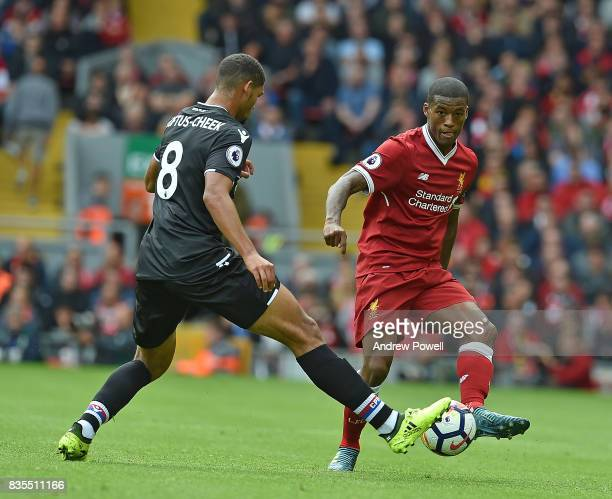 Geoeginio Wijnaldum of Livepool with Ruben LoftusCheek during the Premier League match between Liverpool and Crystal Palace at Anfield on August 19...