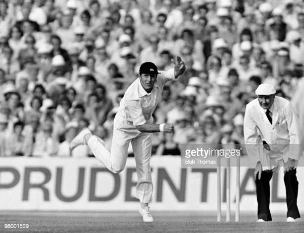 Geoff Boycott bowling for England watched by umpire John Langrdige during the Prudential World Cup SemiFinal against New Zealand at Old Trafford in...