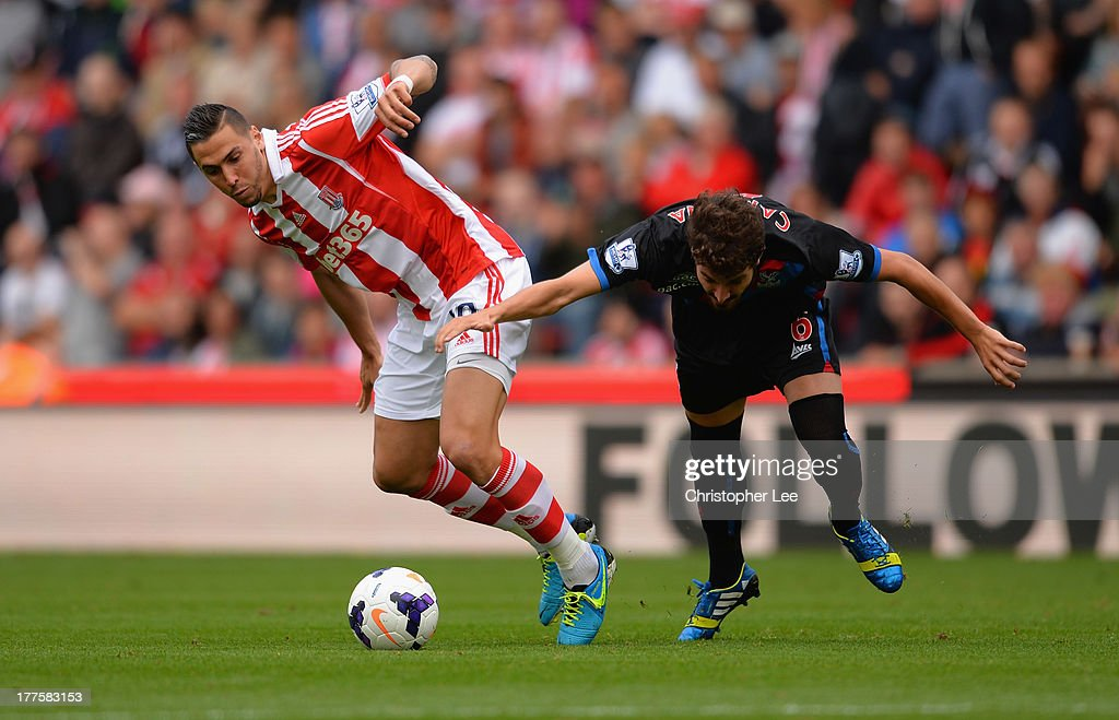 Geoff Cameron of Stoke battles with Jose Campana of Palace during the Barclays Premier League match between Stoke City and Crystal Palace at Britannia Stadium on August 24, 2013 in Stoke on Trent, England.