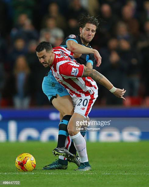 Geoff Cameron of Stoke City and Sam Hutchinson of Sheffield Wednesday compete for the ball during the Capital One Cup match between Stoke City and...