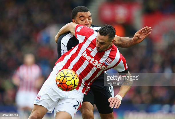 Geoff Cameron of Stoke City and Troy Deeney of Watford compete for the ball during the Barclays Premier League match between Stoke City and Watford...