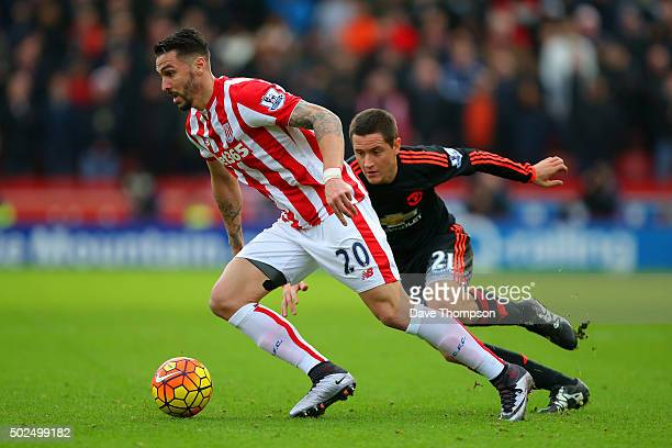 Geoff Cameron of Stoke City battles for the ball with Ander Herrera of Manchester United during the Barclays Premier League match between Stoke City...