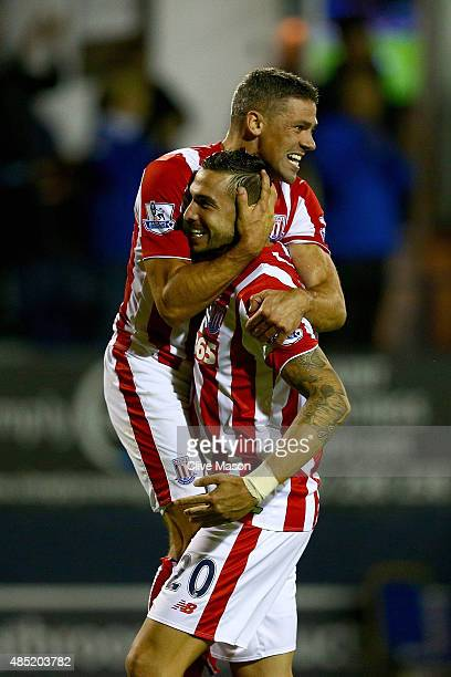 Geoff Cameron of Stoke City celebrates scoring the winning penalty with Jonathan Walters after the penalty shootout during the Capital One Cup second...