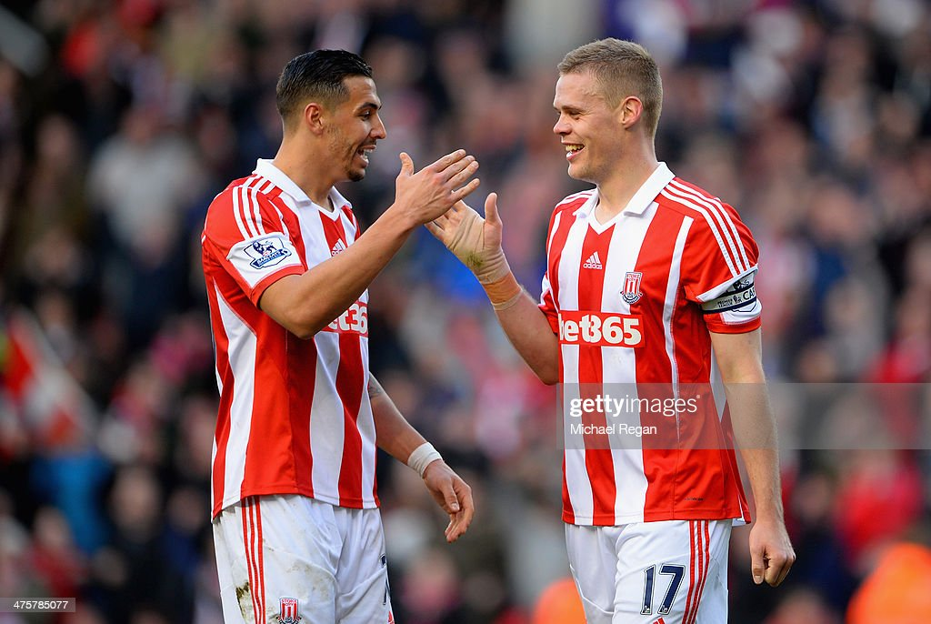 <a gi-track='captionPersonalityLinkClicked' href=/galleries/search?phrase=Geoff+Cameron&family=editorial&specificpeople=5101639 ng-click='$event.stopPropagation()'>Geoff Cameron</a> of Stoke City celebrates with team-mate <a gi-track='captionPersonalityLinkClicked' href=/galleries/search?phrase=Ryan+Shawcross&family=editorial&specificpeople=4443278 ng-click='$event.stopPropagation()'>Ryan Shawcross</a> at the end of the Barclays Pemier League match between Stoke City and Arsenal at the Britannia Stadium on March 1, 2014 in Stoke on Trent, England.
