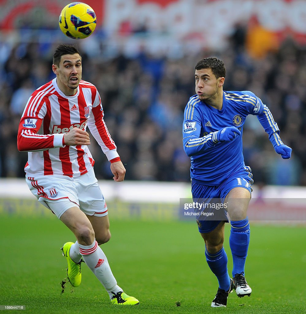 Geoff Cameron of Stoke City competes with Eden Hazard of Chelsea during the Barclays Premier League match between Stoke City and Chelsea at the Britannia Stadium on January 12, 2013, in Stoke-on-Trent, England.