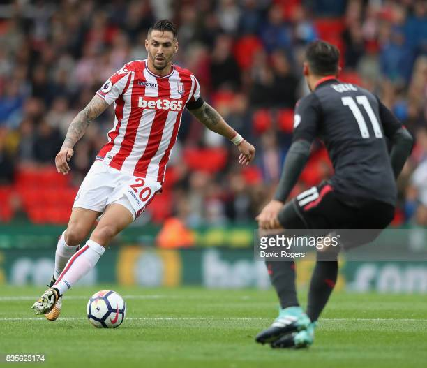 Geoff Cameron of Stoke City moves away with the ball during the Premier League match between Stoke City and Arsenal at Bet365 Stadium on August 19...