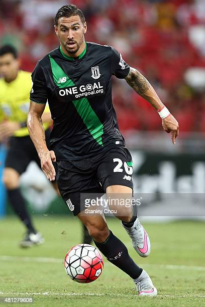 Geoff Cameron of Stoke City runs with the ball during the Barclays Asia Trophy 3rd placing match between Stoke City and Singapore at the National...