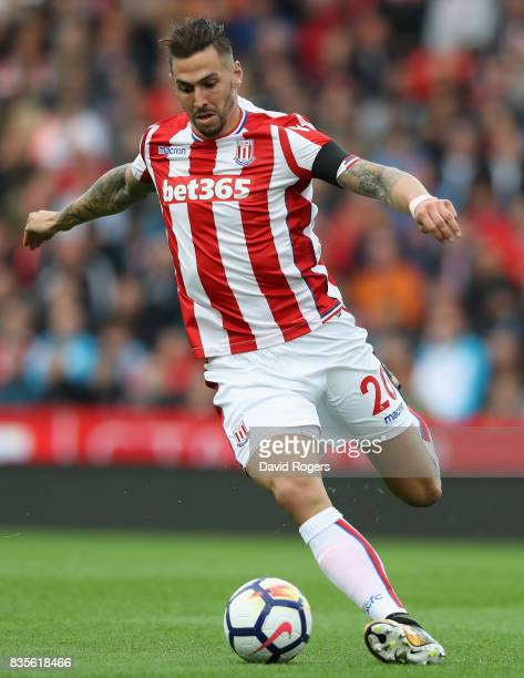 Geoff Cameron of Stoke City runs with the ball during the Premier League match between Stoke City and Arsenal at Bet365 Stadium on August 19 2017 in...