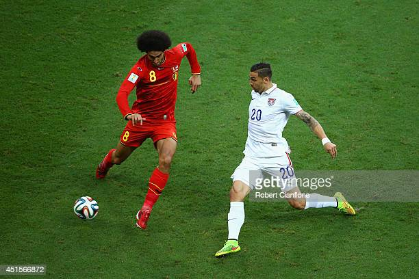 Geoff Cameron of the United States challenges Marouane Fellaini of Belgium during the 2014 FIFA World Cup Brazil Round of 16 match between Belgium...