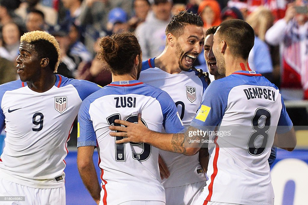 Geoff Cameron of the United States Men's National Team celebrates his first half goal against Guatemala with Graham Zusi of the United States Men's...