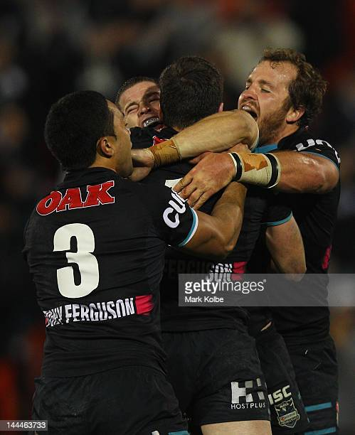 Geoff Daniela Travis Burns and Clint Newton of the Panthers celebrate with Lachlan Coote of the Panthers after he kicking a field goal in golden...