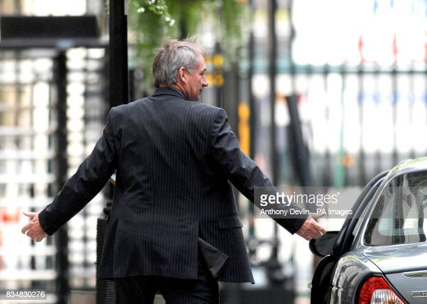 Geoff Hoon shrugs his shoulders as he leaves 10 Downing street London