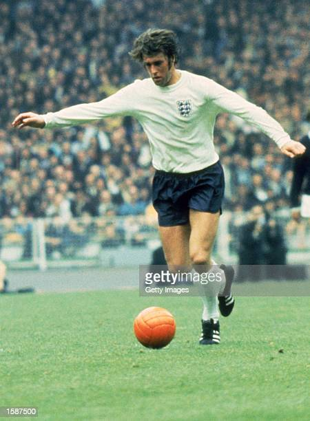 Geoff Hurst of England runs with the ball during the Home Championship and European Championships Qualifying match between England and Scotland held...