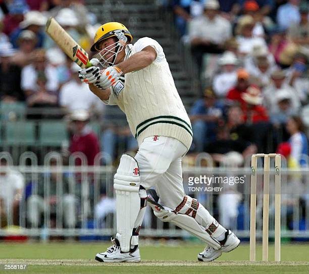 Geoff Marsh coach for Zimbabwe smashes a boundary during the Australian Cricket Board Chairman's X1 at Lilac Hill in Perth 01 October 2003 AFP...