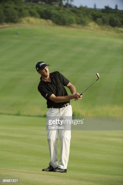 Geoff Ogilvy chips onto the 18th green during the final round of the SBS Championship at Plantation Course at Kapalua on January 10 2010 in Kapalua...