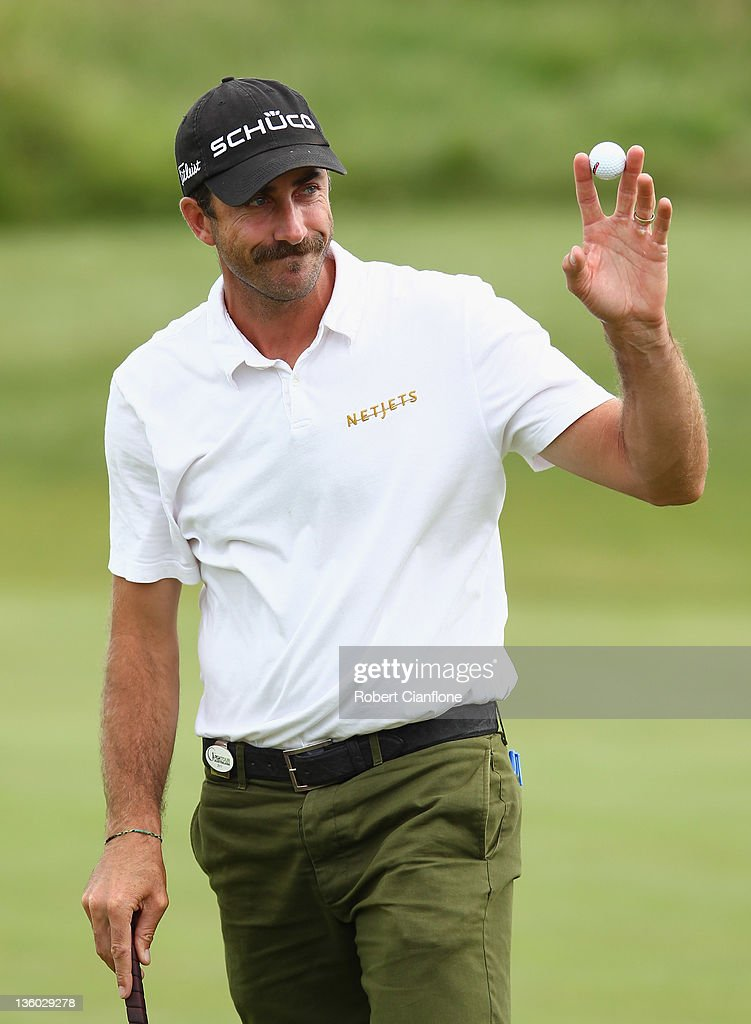 <a gi-track='captionPersonalityLinkClicked' href=/galleries/search?phrase=Geoff+Ogilvy&family=editorial&specificpeople=224652 ng-click='$event.stopPropagation()'>Geoff Ogilvy</a> of Australia acknowledges the crowd after completing his round during day three of the 2011 Australian Masters at The Victoria Golf Club on December 17, 2011 in Melbourne, Australia.