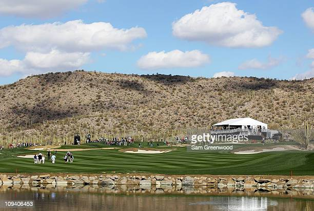 Geoff Ogilvy of Australia and Thomas Bjorn of Denmark walk down the fourth fairway with their caddies during the second round of the Accenture Match...