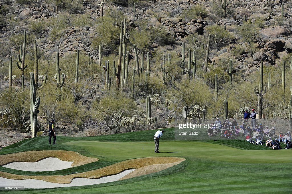 Geoff Ogilvy of Australia hits a putt on the 14th green during the second round of the World Golf Championships-Accenture Match Play Championship at The Ritz-Carlton Golf Club, Dove Mountain on February 24, 2011 in Marana, Arizona.