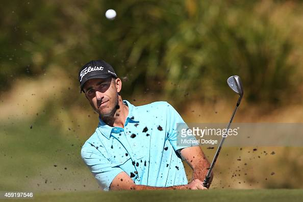 Geoff Ogilvy of Australia hits an approach shot out of a bunker during the ProAm ahead of the 2014 Australian Masters at The Metropolitan Golf Course...
