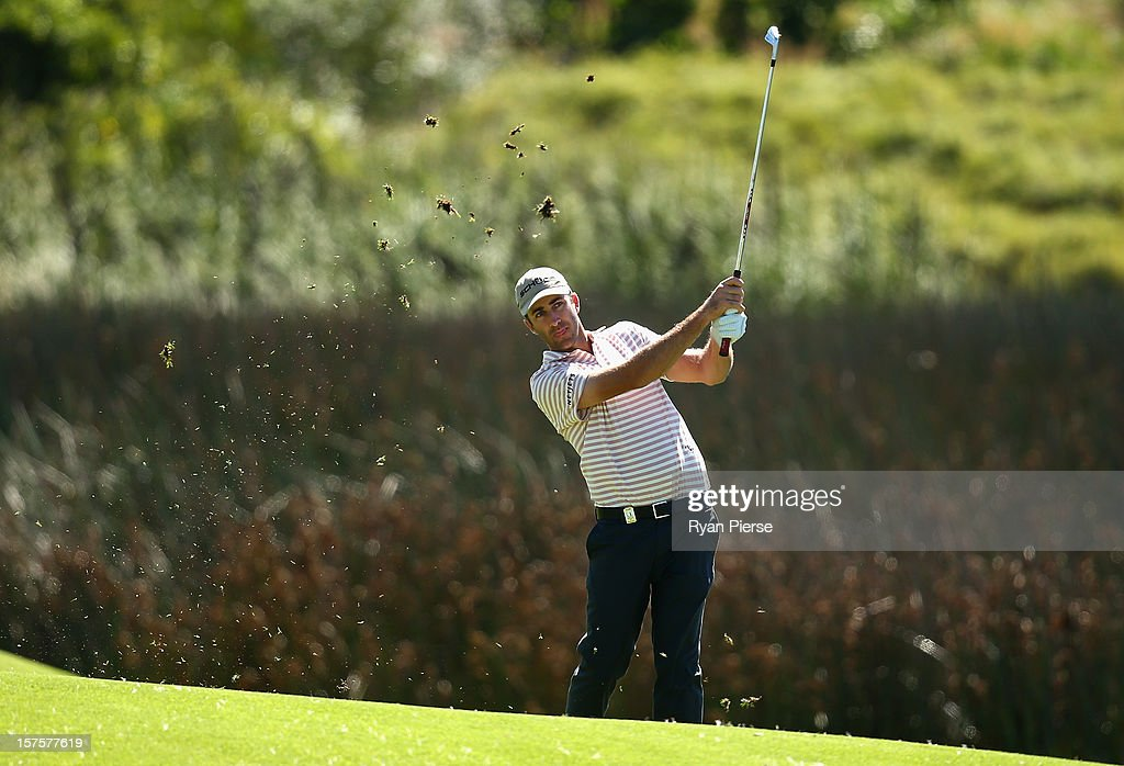 Geoff Ogilvy of Australia hits an iron shot during the Pro-Am ahead of the 2012 Australian Open, beginning tomorrow, at The Lakes Golf Club on December 5, 2012 in Sydney, Australia.