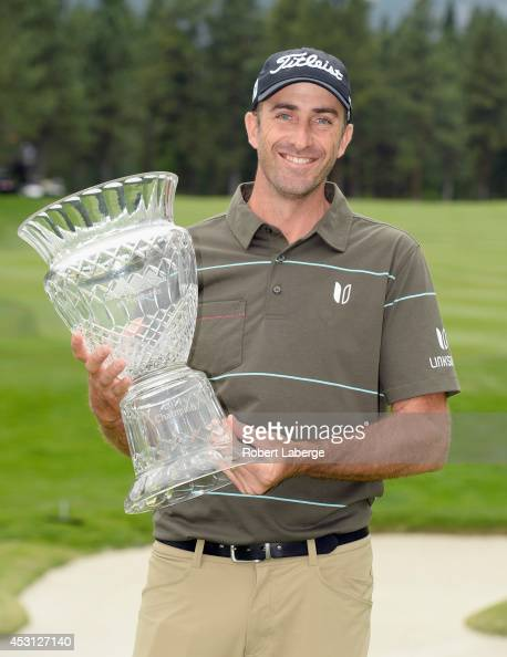 Geoff Ogilvy of Australia holds the trophy after winning the Barracuda Championship at the Montreux Golf and Country Club on August 3 2014 in Reno...