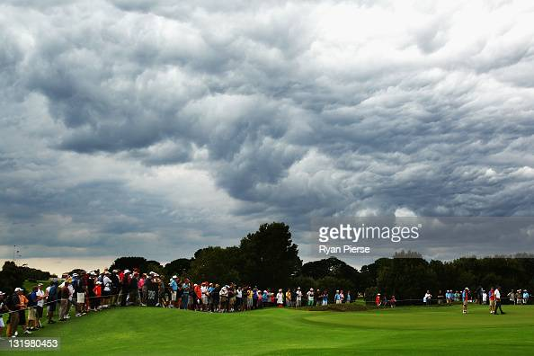 Geoff Ogilvy of Australia lines up a putt on the 15th Hole as storm clouds approach during day one of the 2011 Emirates Australian Open at The Lakes...