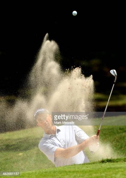 Geoff Ogilvy of Australia plays a bunker shot during day three of the Australian Open at Royal Sydney Golf Club on November 30 2013 in Sydney...